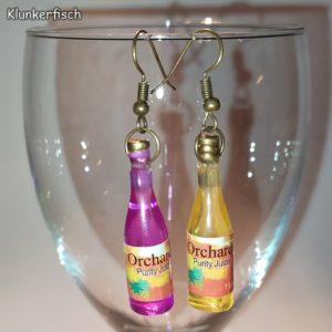 Witzige Ohrringe mit Saft-Flaschen in Pink und Gelb
